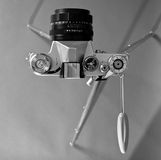 Old film camera and retro steel tripod Royalty Free Stock Photography