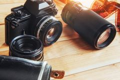 Old film camera and a roll of on wood. Old film camera and a roll of film on wood Stock Photo
