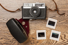 Old film camera and slides Stock Photo