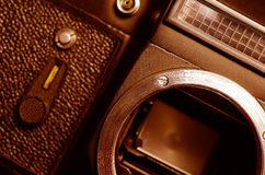 Old film camera. The old SLR camera without lens. The metal bayonet lens mount. Photographic exposure meters. Self-timer shutter. Mirror. Front view. Macro royalty free stock images