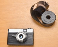 Old film camera and some film Royalty Free Stock Image