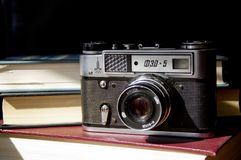 Old film camera on the table stock photo