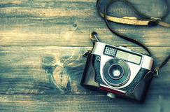 Old film camera. Vintage style toned picture with lens blur Stock Images