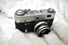 Old film camera. On white background stock images