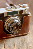 Old film camera. On wooden background stock images
