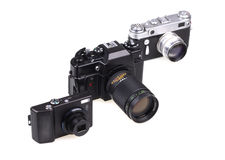 Old film cameras and the modern compact camera Royalty Free Stock Photography