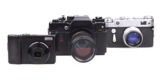 Old film cameras and the modern compact camera Royalty Free Stock Photos
