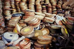 Old film canisters. Old movie film canisters, abandoned and rusty royalty free stock photos