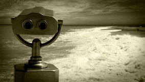Old film effect footage: a tourist telescope overlooks the rough sea stock video
