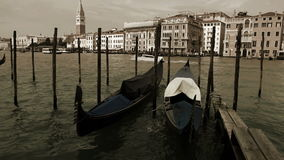 Old film effect footage of the Venetian gondolas rocking on the waves in front of Piazza San Marco stock footage