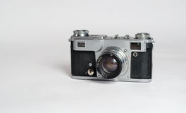 Old film fotoaparat. Old scratched camera standing on a white background Stock Image
