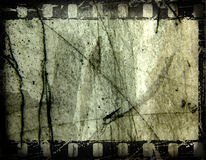 Old film frame. Film strip, with grunge effects, on textured surface. Space for text or image insertion stock illustration