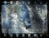 Old film frame. Old film strip, with grunge background stock illustration