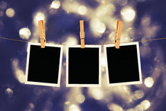 Old Film Frame Abstract. Old photo film blanks hanging on a rope held by clothespins on bokeh lights background Stock Photos