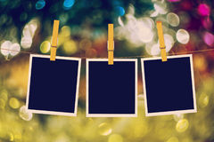 Old Film Frame Abstract. Old photo film blanks hanging on a rope held by clothespins on bokeh lights background Royalty Free Stock Photography