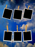 Old Film Frame over Sky. Old photo film blanks hanging on a rope held by clothespins over blue sky Royalty Free Stock Photo