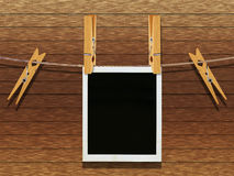 Old Film Frame over Wood. Old photo film blanks hanging on a rope held by clothespins over wooden background Royalty Free Stock Photography