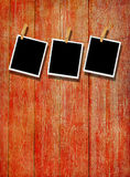 Old Film Frame over Wood. Old photo film blanks hanging on a rope held by clothespins over wooden background Royalty Free Stock Images