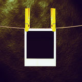 Old Film Frame Template. Old photo film blanks hanging on a rope held by clothespins Royalty Free Stock Image