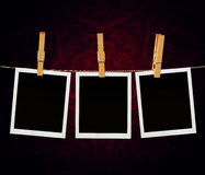 Old Film Frame Template. Old photo film blanks hanging on a rope held by clothespins Royalty Free Stock Photos