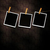 Old Film Frame Template. Old photo film blanks hanging on a rope held by clothespins Stock Images