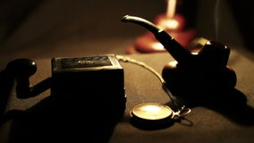 Old Film military scene: smoking pipe, morse telegraph key,pocket watch and desk Lamp Stock Photography