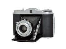 Old film photo camera - rangefinder, folding lens. A retro photographic camera, a rangefinder with (accordion) folding lens Royalty Free Stock Images