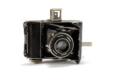 Old film photo camera on white background Stock Photos