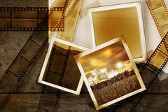 Old film and photos on distressed wood panels. Old film and photos on distressed wood background Stock Photo