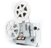 Old film projector isolated on a white background. Old film projector on a white background Royalty Free Stock Photo