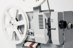 Old film projector isolated on a white background. Old film projector on a white background Stock Photography