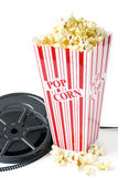 Old film reel with popcorn. Vintage film reel with popcorn Royalty Free Stock Photography