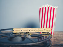Old film reel, popcorn and tickets Stock Photos