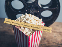 Old film reel, popcorn and tickets Stock Photography