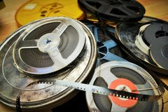 Old film reels. On a wooden floor royalty free stock image