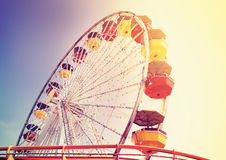 Old film retro style picture of an amusement park.  Stock Photography