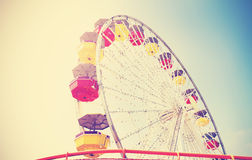 Old film retro style picture of ferris wheel. Stock Image