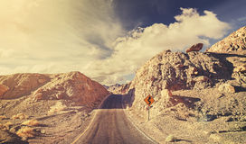 Old film retro stylized rocky desert road. Old film retro stylized rocky desert road, USA Stock Photos