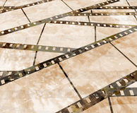 Old film strip. With some spots Stock Photography