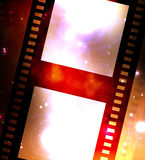 Old film strip. Old negative coloured film strip on a dark background Stock Photography