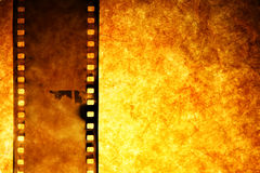 Old film strip. Over grunge paper background Stock Photography