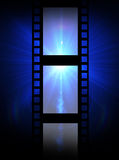 Old film strip on a blue background Stock Photography