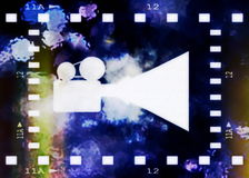 Old film strip frame and movie projector Royalty Free Stock Photo