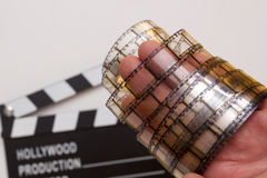 Old film strip in the man's hand stock image