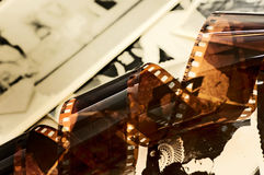 Old film strip and photos background stock image