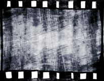 Old film strip. With some spots Royalty Free Stock Photo
