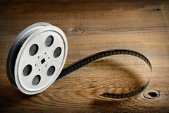 Old film strip on wooden background. Top view. Stock Image