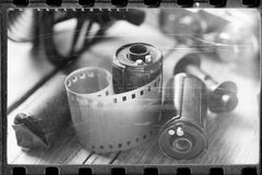 Old film stylized photo of rolled up film, cassette and camera. Old film stylized photo of rolled up film, cassette and retro camera. Vintage effect Stock Image