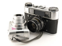 Old Films Camera with Digital Camera. On the white background stock photos
