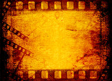 Old filmstrip on the paper. Abstract background Stock Photos